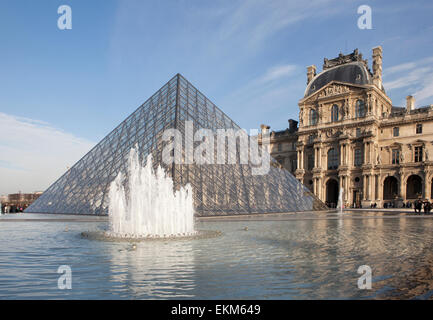 The Louvre Pyramid and Palace in Paris - Stock Photo