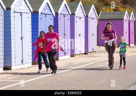 Bournemouth, UK. 12th April, 2015. Children and parents taking part in the 1k children fun run/family friendly run, - Stock Photo