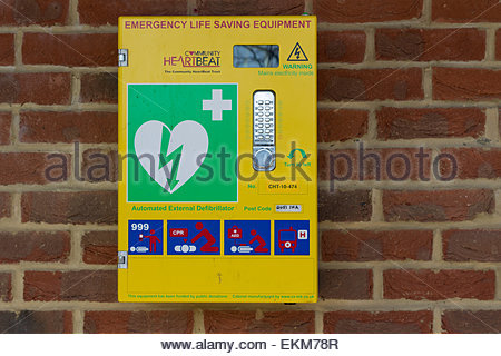 A public access automated external defibrillator mounted on the wall of a Community Centre - Stock Photo