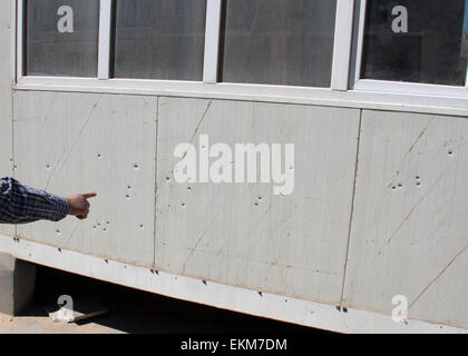 Tripoli, Libya. 12th Apr, 2015. Bullet holes are seen on the sentry box outside the South Korea's embassy in Tripoli, - Stock Photo