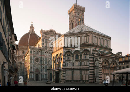 Italy cathedral, view at sunrise towards the Duomo and Baptistry in the Piazza San Giovanni, Florence, Italy. - Stock Photo