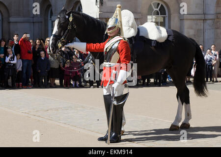 Changing the guards at Horseguards Parade the dismount - Stock Photo