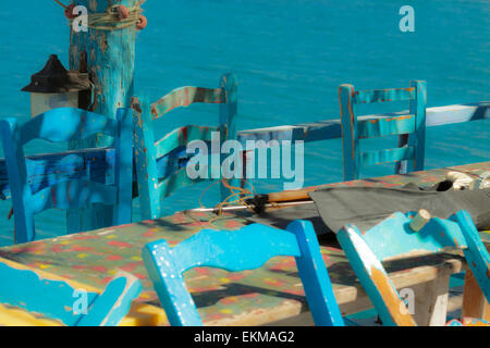 Mediterranean mood and typically Greek blue chairs in Matala, situated on the Bay of Messara, Heraklion region, - Stock Photo