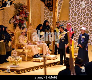 Bandar Seri Begawan, Brunei. 12th April, 2015. Brunei's Sultan Hassanal Bolkiah (2nd R front) attends the royal - Stock Photo