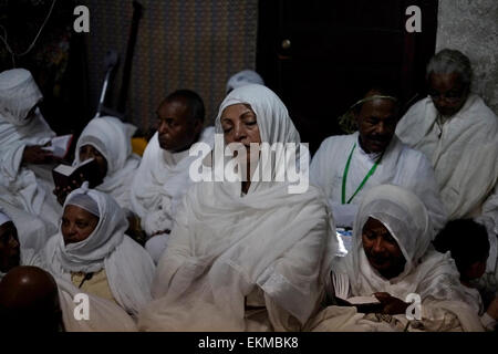 "Ethiopian Orthodox worshipers gathered during 'Holy Fire' ceremony at the ""Four Animals' chapel in Deir El-Sultan - Stock Photo"