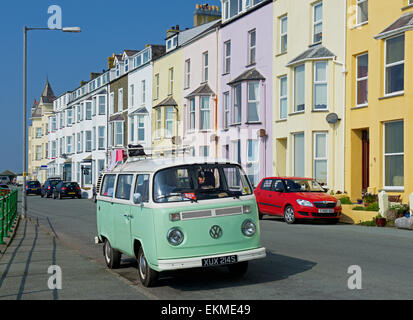 VW campervan parked in front of hotels in Tenby, Pembrokeshire, Wales UK - Stock Photo