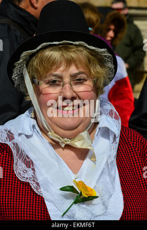 A woman dressed in traditional Welsh bonnet and costume at the Pan Celtic Nations festival in Derry, Londonderry - Stock Photo
