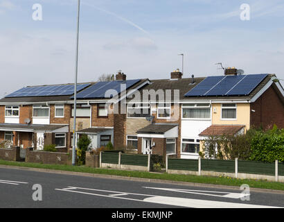 Houses with solar panels on the roofs - Stock Photo