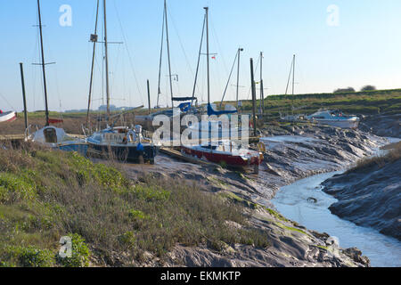 Boats on mud at low tide on river Axe at Uphill boat yard near Weston-super-Mare North Somerset - Stock Photo