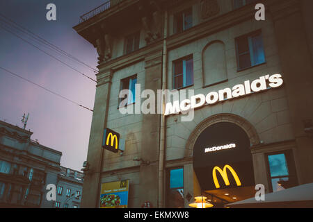 MINSK, BELARUS - JULY 20, 2014: McDonalds restaurant sign. McDonald's Corporation is the world's largest chain of - Stock Photo