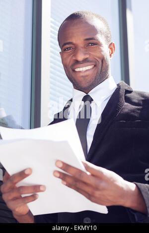 happy black businessman documents handling - Stock Photo