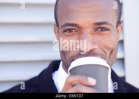 trendy black man have coffee break outdoors - Stock Photo