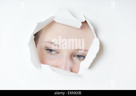 young woman peeking - Stock Photo