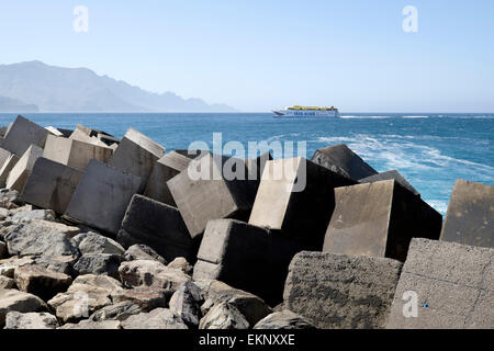 A fast ferry catamaran belonging to the Fred Olsen Line arriving from Tenerife at the well protected exposed coast - Stock Photo