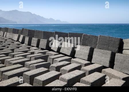 Hard engineering rectangular concrete blocks used to limit coastal erosion, Puerto de las Nieves, Gran Canaria, - Stock Photo