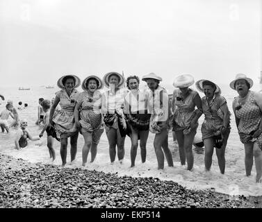 A group of elderly women go for a paddle in the cold sea at Southend, Essex. 1st July 1957. - Stock Photo