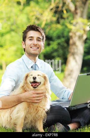 Businessman's best friend - Stock Photo