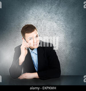 Modern young businessman talking on smartphone - Stock Photo