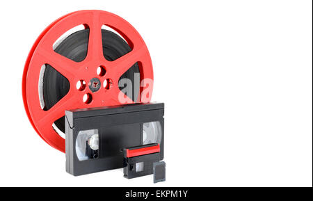 old reel of film, video tape and memory card on white - Stock Photo