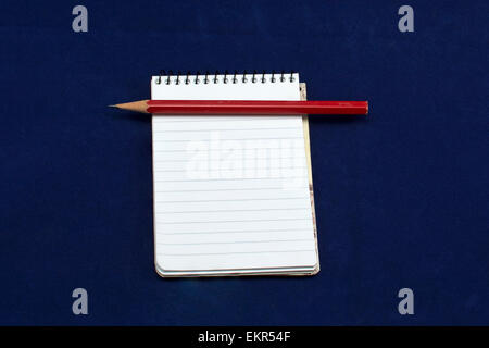 Note book and red pencil - Stock Photo