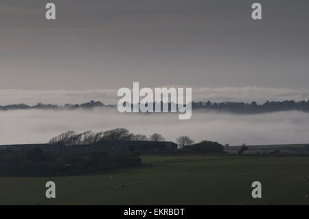 East Dean, Eastbourne, East Sussex, UK. 13 April 2015. Weather: Sea mist moves in creating layers in the valley. - Stock Photo