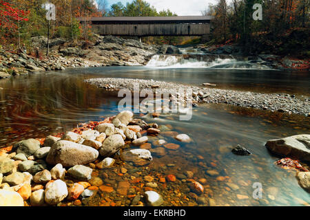 Low Angle View of the Swiftwater Covered Bridge Over the Wild Ammonoosuc River, Bath, New Hampshire - Stock Photo