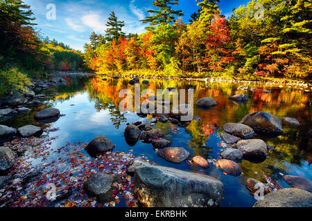 Low Angle View of a Calm River with Colorful Tree Reflections, Swift River, White Mountains National Forest, New - Stock Photo