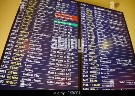 International Departures Board Birmingham Airport UK - Stock Photo