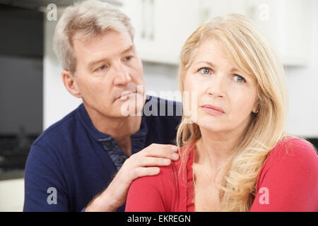 Mature Man Comforting Woman With Depression - Stock Photo