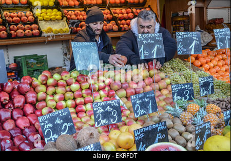 Vienna Naschmarkt food stand  fruit with two sellors - Stock Photo