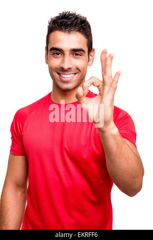 Man showing Ok sign over white background - Stock Photo