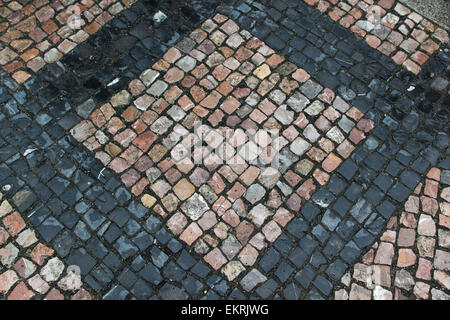 Road site laid out by small color stones in the form of squares. - Stock Photo