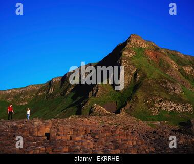Co Antrim,Northern Ireland;People Standing On The Giant's Causeway - Stock Photo