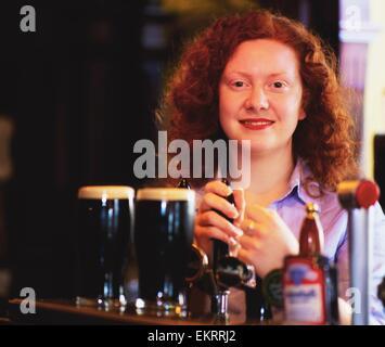Dublin,Ireland;Barmaid In Traditional Pub - Stock Photo