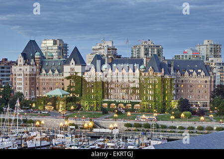 The Fairmont Empress hotel sits majestically at the cornerstone of Inner Harbour; Victoria, Vancouver Island, Canada - Stock Photo