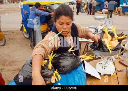 Woman With Bags Of Chickens, Lima, Peru - Stock Photo