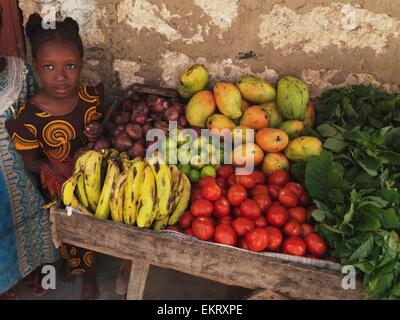Girl With A Cart Of Fresh Produce In Kenya, Africa - Stock Photo