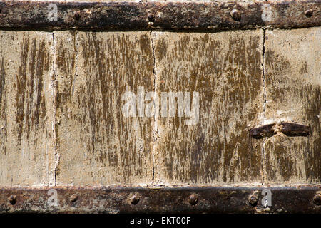 Very old wooden door with rusting iron fittings - Stock Photo