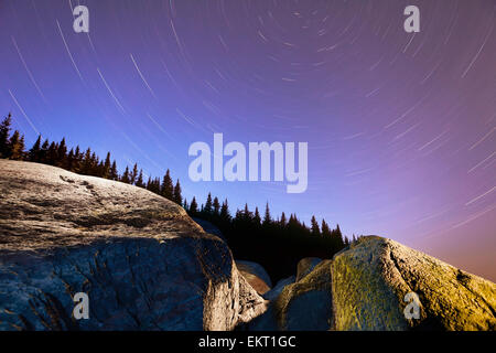 Star Trails Over Rocks In Saguenay-St. Lawrence Marine Park; Ile-Aux-Lievres Quebec Canada - Stock Photo