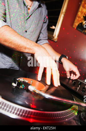 Disc Jockey Plays Recorded Music From A Vinyl Record; Gold Coast Queensland Australia - Stock Photo