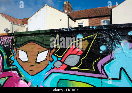 graffiti on wall, back of terraced houses, norwich, norfolk, england - Stock Photo
