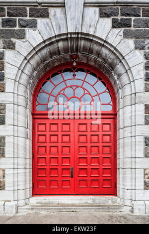 Red Door Of An Old Stone Church Sainte-Croix Church;Sainte-Croix Quebec Canada - Stock Photo