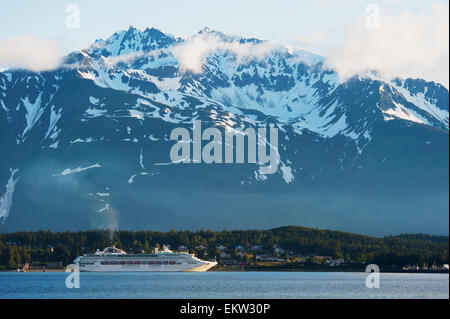 Scenic view of a cruise ship moored at Haines with coastal mountains in the background, Inside Passage, Southeast - Stock Photo