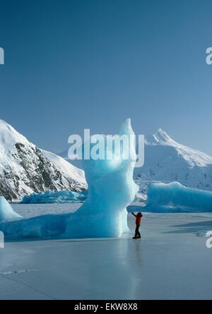 Iceberg On Frozen Lake W/ W/Out Couple Winter Sc Ak - Stock Photo
