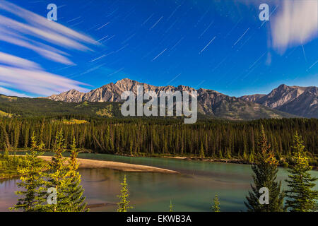 August 8, 2014 - The stars of Andromeda and Perseus rising over the Front Ranges and Bow River in Banff, Alberta, - Stock Photo