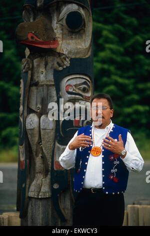 Alaskan Native Guide Addresses Cruiseship Passengers @ Totem Pole Site Kake Southeast Alaska - Stock Photo
