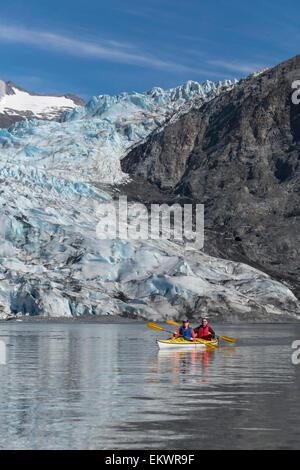Couple sea kayaking at Shoup Bay State Marine Park, Prince William Sound, Valdez, Southcentral Alaska - Stock Photo