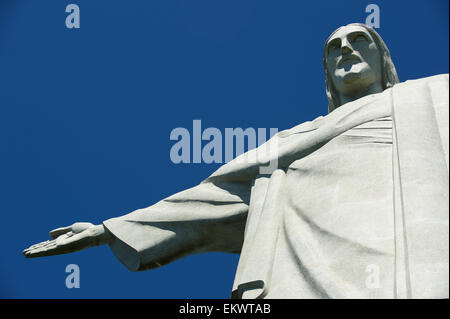 RIO DE JANEIRO, BRAZIL - MARCH 05, 2015: Close-up of the statue of Christ the Redeemer at Corcovado against bright - Stock Photo