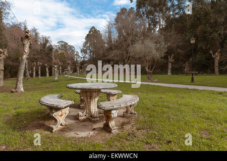 Concrete and stone round picnic tables in a park public. - Stock Photo