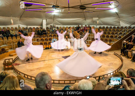 Whirling Dervishes and tourists, Pamukkale, Turkey - Stock Photo